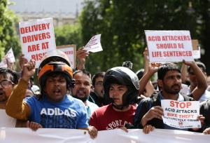 Asian Image: Food delivery riders demonstrate in Parliament Square following moped acid attacks after five separate male victims were targeted by two moped-riding attackers in the north and east of the capital .