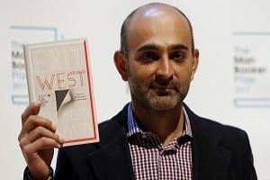 Author Mohsin Hamid of Britain and Pakistan with his book 'Exit West' during a photocall with all six shortlisted authors of the 2017 Man Booker Prize for Fiction, in London.