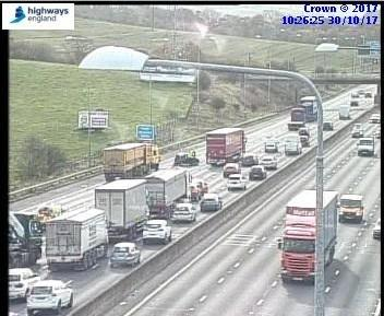 Traffic queuing eight miles after crash involving lorry and
