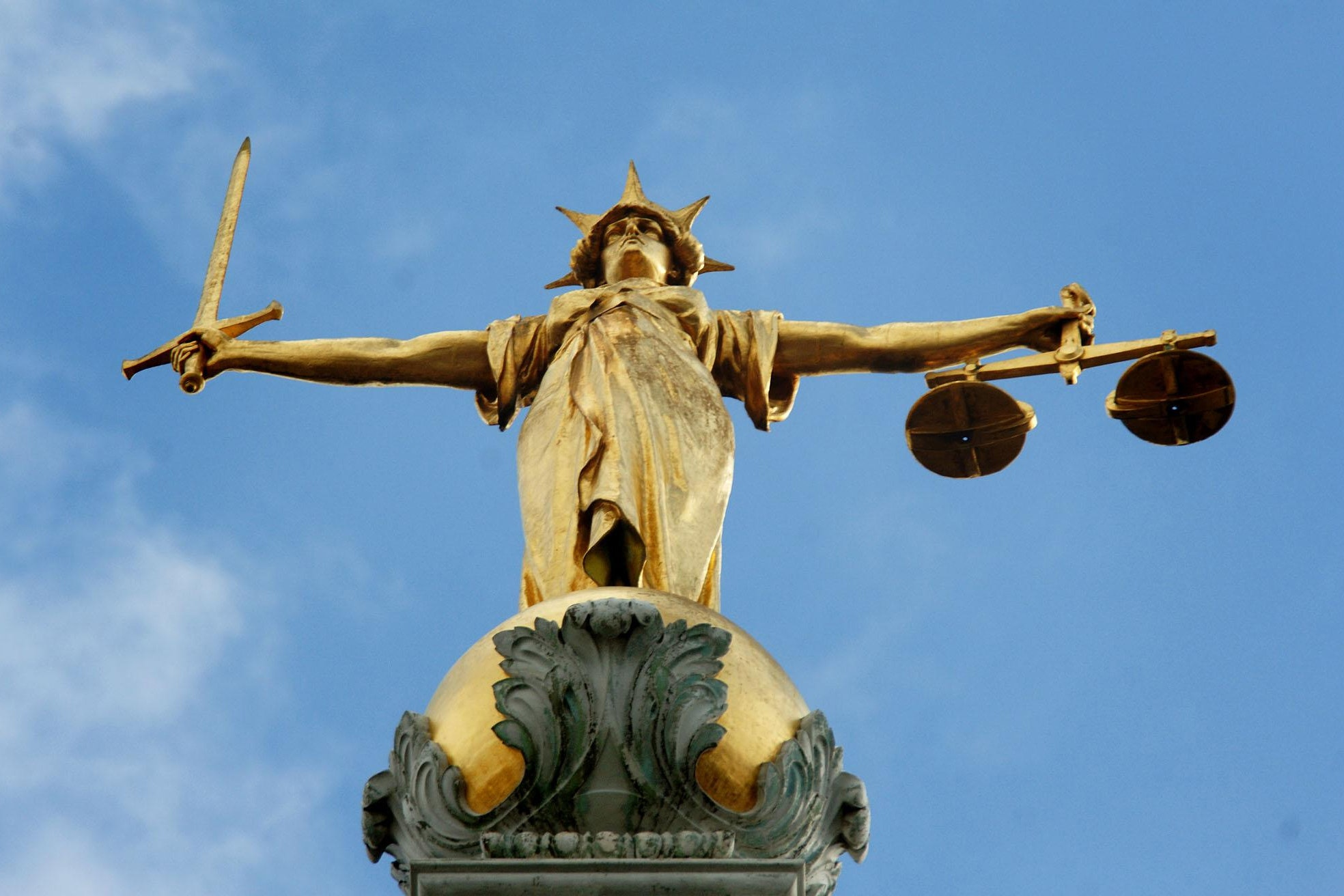 Embargoed to 0001 Friday September 22 File photo dated 6/3/07 of Lady Justice, holding scales and a sword, on top of the Central Criminal Court, also referred to as Old Bailey, in central London. Access to legal aid should be significantly expanded amid c