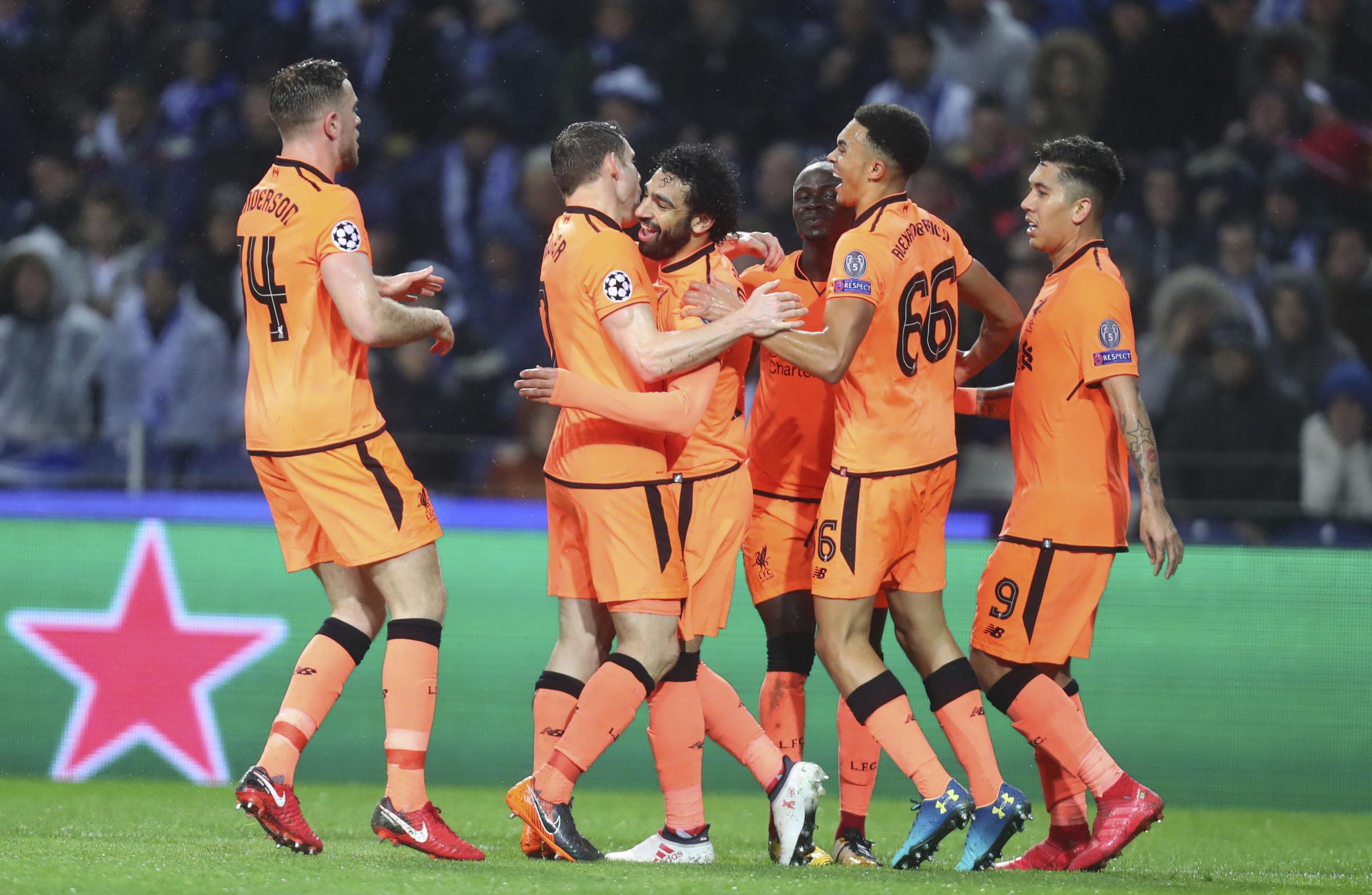 Liverpool's Mohamed Salah, left, celebrates with teammate Danny Ings at the end of the Champions League round of sixteen first leg soccer match between FC Porto and Liverpool  (AP/Luis Vieira)