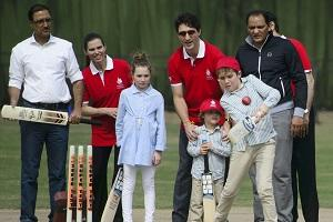 Canadian Prime Minister Justin Trudeau, center, and children, Xavier, 10, Ella-Grace, 9, and Hadrien, 3, visit the Modern School's cricket pitch in New Delhi, India Thursday, Feb. 22, 2018. (Sean Kilpatrick/The Canadian Press via AP).