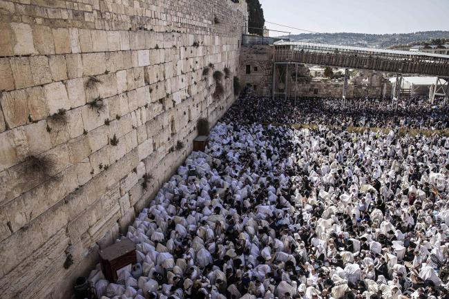 Ultra-Orthodox Jewish men of the Cohanim Priestly caste participate in a blessing during the Jewish holiday of Passover, at the Western Wall, the holiest site where Jews can pray in Jerusalem's Old City, Monday, April 2, 2018.