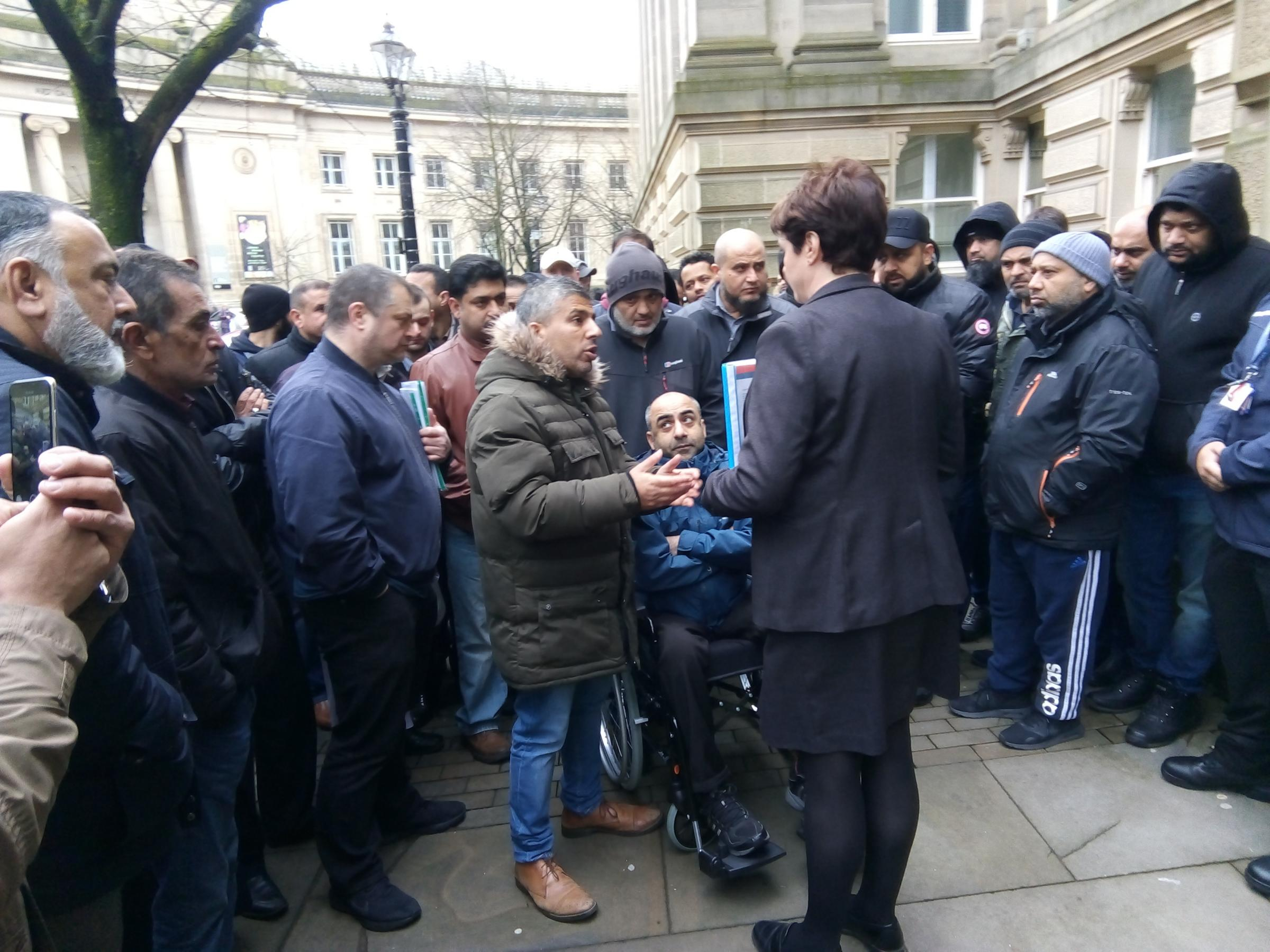 Asif Vali led the strike outside Bolton Town Hall
