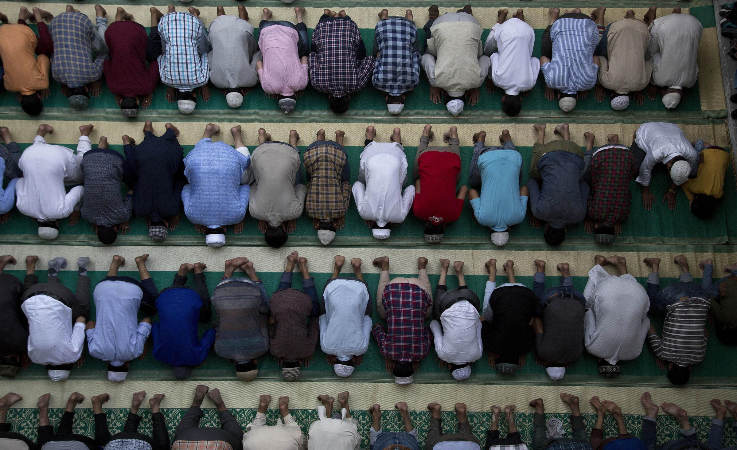 People offer prayers at a mosque during the month of Ramadan in Dehradun, India. Islam's holiest month is a period of intense prayer, dawn-to-dusk fasting and nightly feasts. (APAnupam Nath).