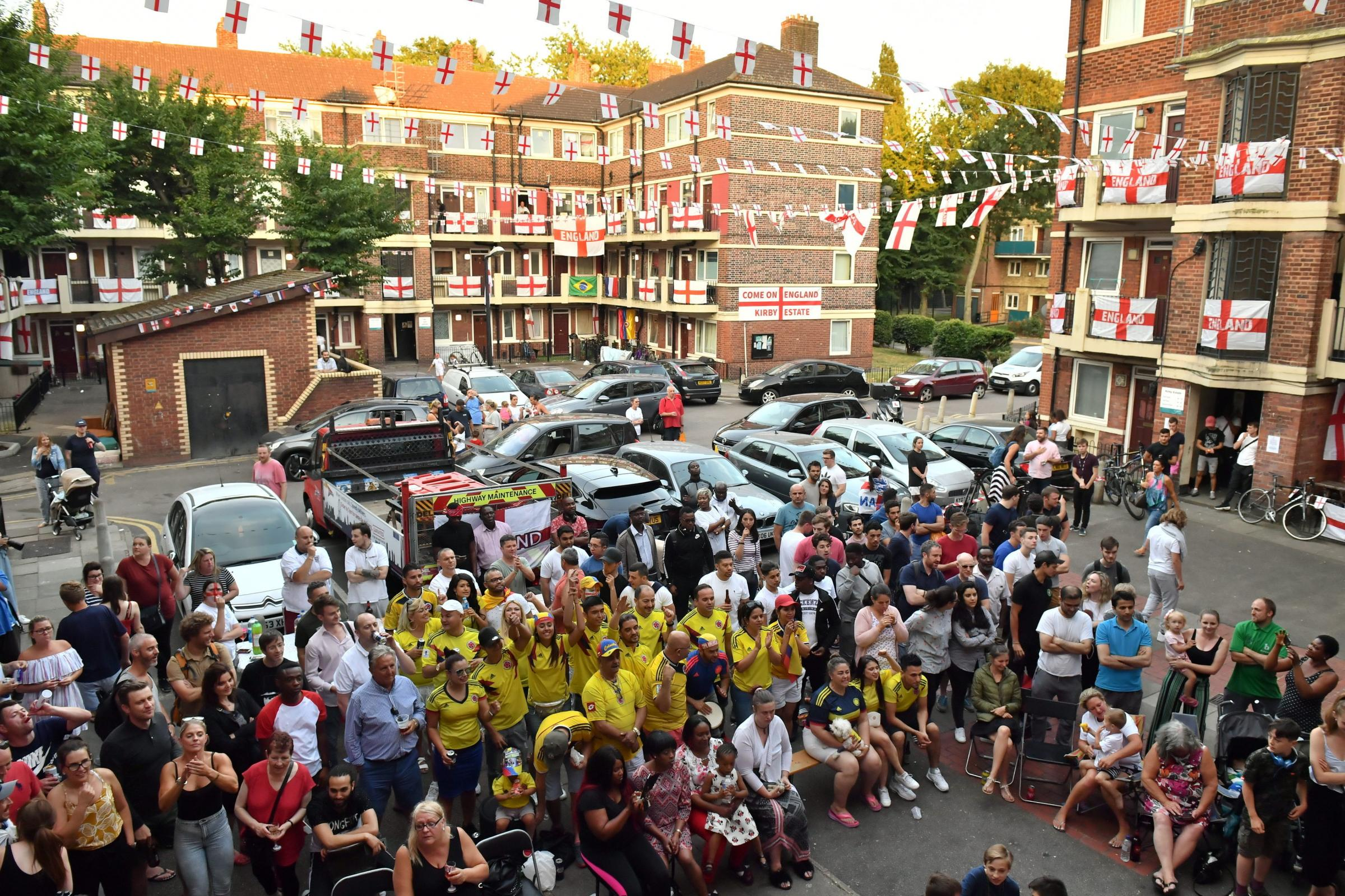 Fans of England and Colombia watch the World Cup match between the two nations on the Kirby Estate in Bermondsey, south London. (Dominic Lipinski/PA)