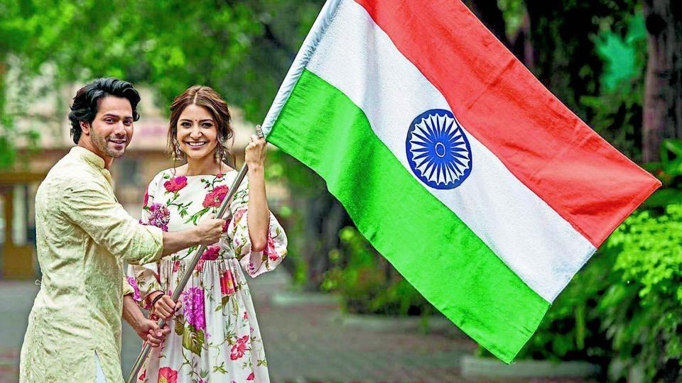 Anushka and Varun were pictured with a handmade Indian flag.