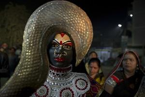 An Indian artist dressed as Hindu Goddess Kali performs participates in a procession as part of Dussehra festival celebrations in Allahabad, India, Monday, Oct. 15, 2018. The Hindu festival Dussehra commemorates the triumph of Lord Rama over the demon king Ravana, marking the victory of good over evil. (AP/Rajesh Kumar Singh).