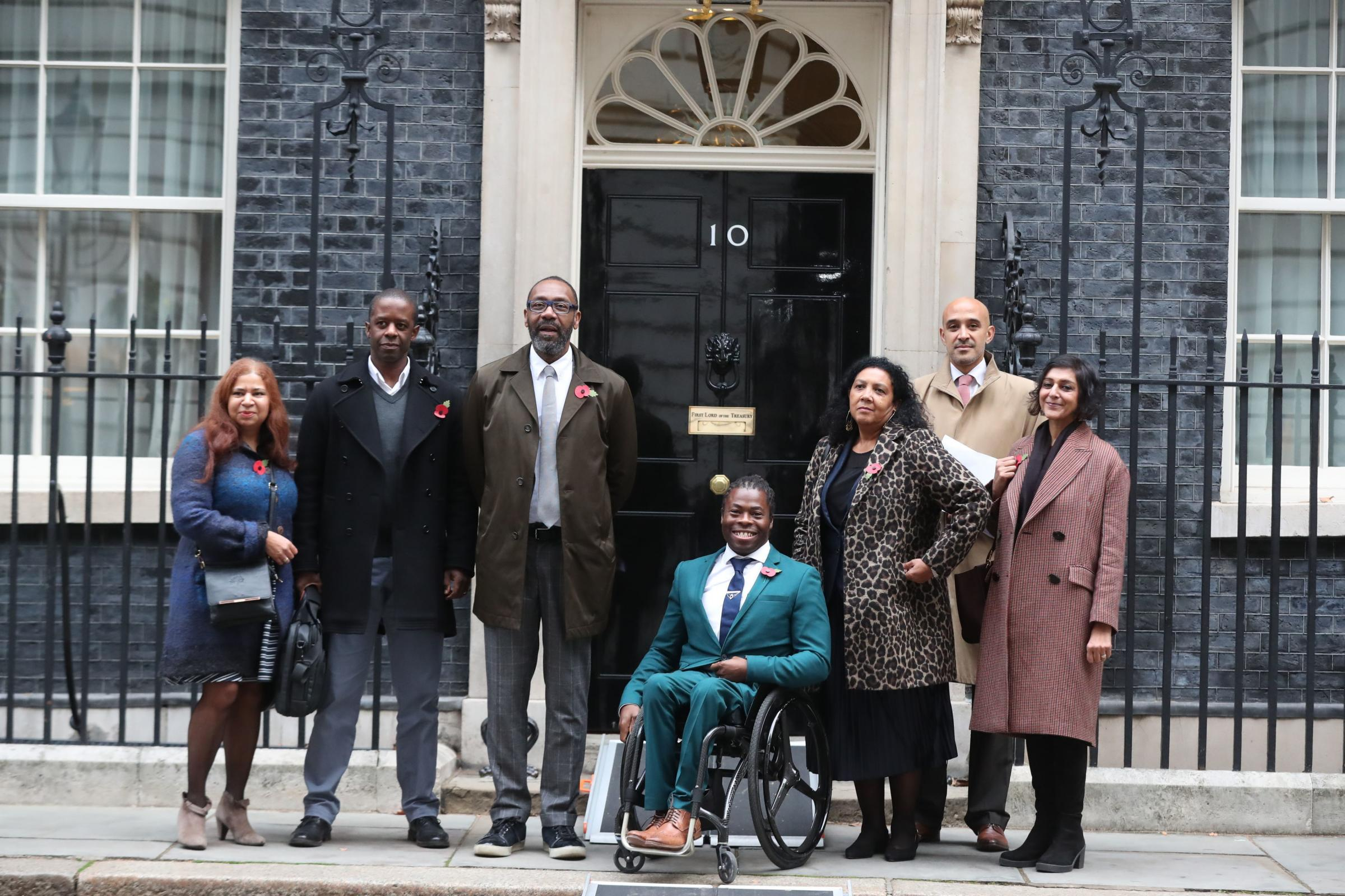(From second left) Adrian Lester, Sir Lenny Henry, Ade Adepitan, Nadine Marsh-Edwards, Marcus Ryder and Meera Syal, as they deliver a letter, signed by a string of stars, to 10 Downing Street,