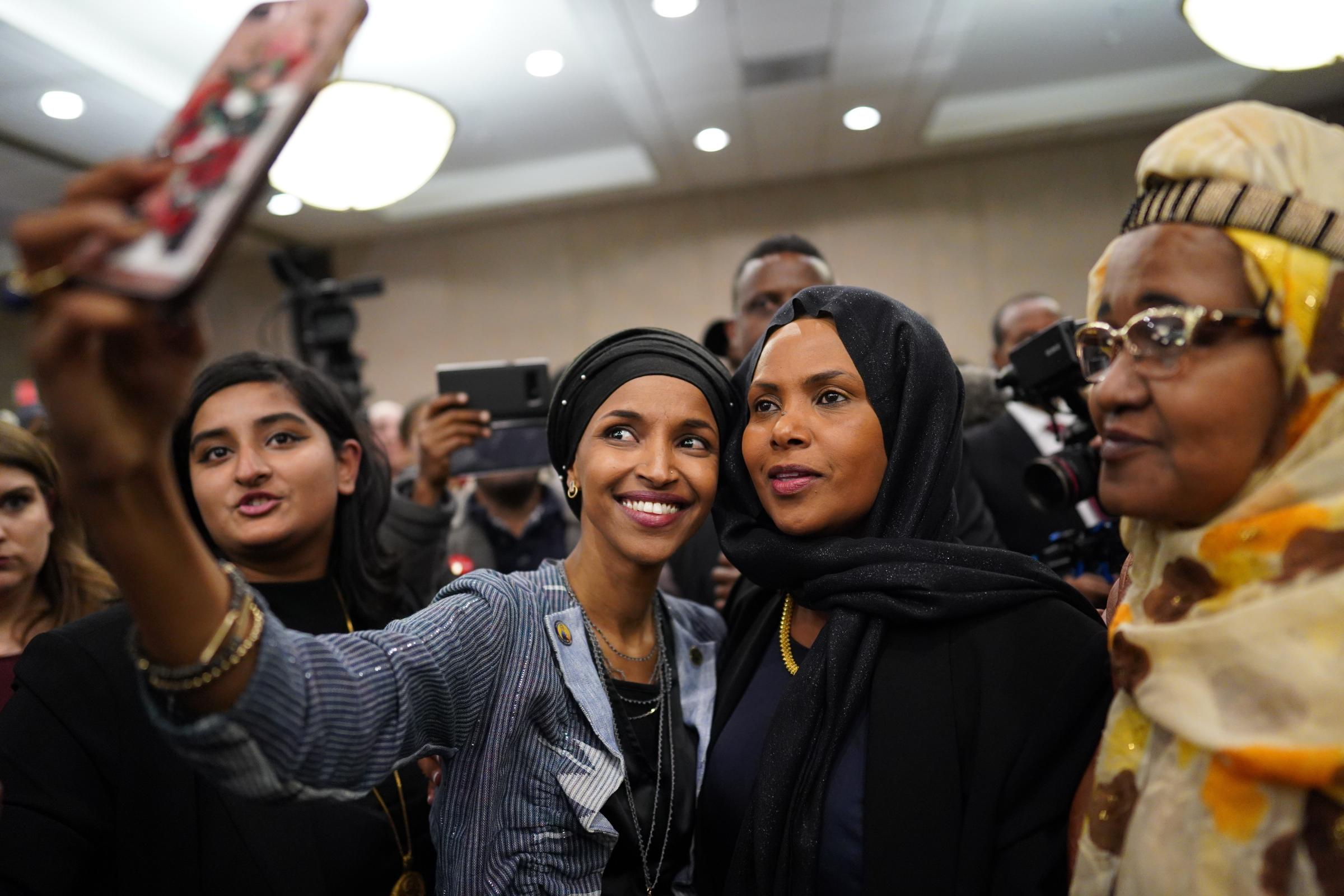 Ilhan Omar poses for selfies