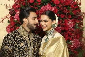 Bollywood actors Deepika Padukone, right, and Ranveer Singh pose at their wedding reception in Bangalore, India, Wednesday, Nov. 21, 2018. The couple got married at Villa Balbianello, a lakeside mansion featured in Star Wars and James Bond films in Lenno, Como lake, northern Italy on Nov. 14, 2018. (AP Aijaz Rahi).