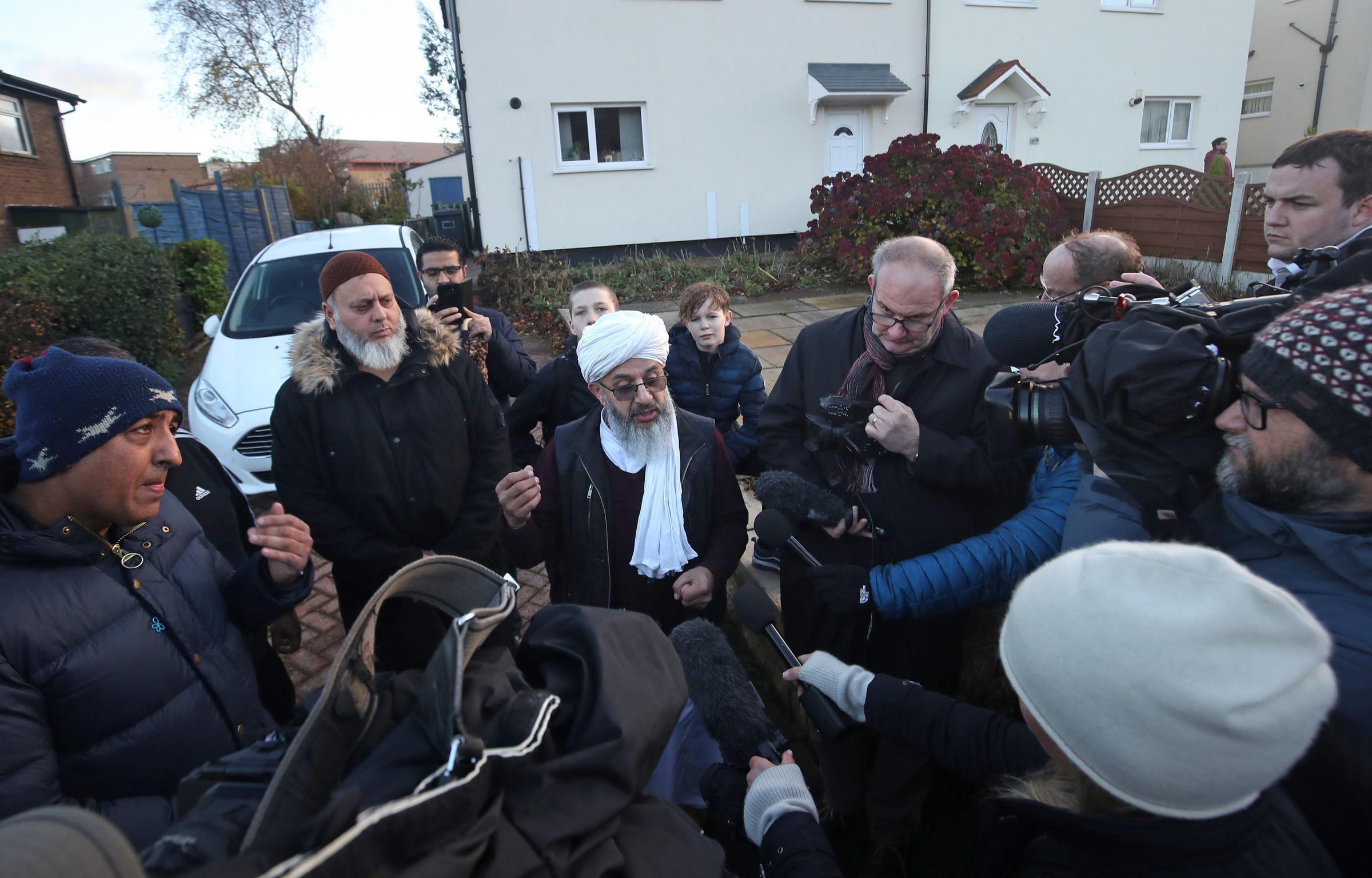 Imam Mohammed Amin Pandor speaking to the media at a peaceful protest outside Almondbury Community School, in Huddersfield after footage was shared on social media of a 15-year-old Syrian refugee being attacked at the school.