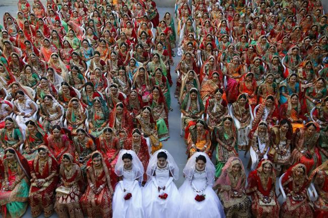 IN PICTURES: 261 couples are married in mass wedding
