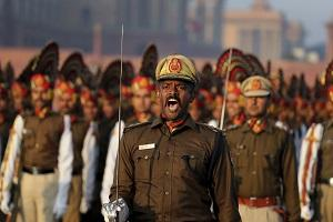 A commander of Indian Railway protection force commands his troops to march during the rehearsals for the upcoming Republic Day parade on Rajpath, the ceremonial boulevard, in New Delhi, India, Monday, Jan. 14, 2019. India celebrates Republic Day on Jan. 26, highlighted by a march past by different branches of the military as well as a display of arms and missiles. (AP/Manish Swarup).