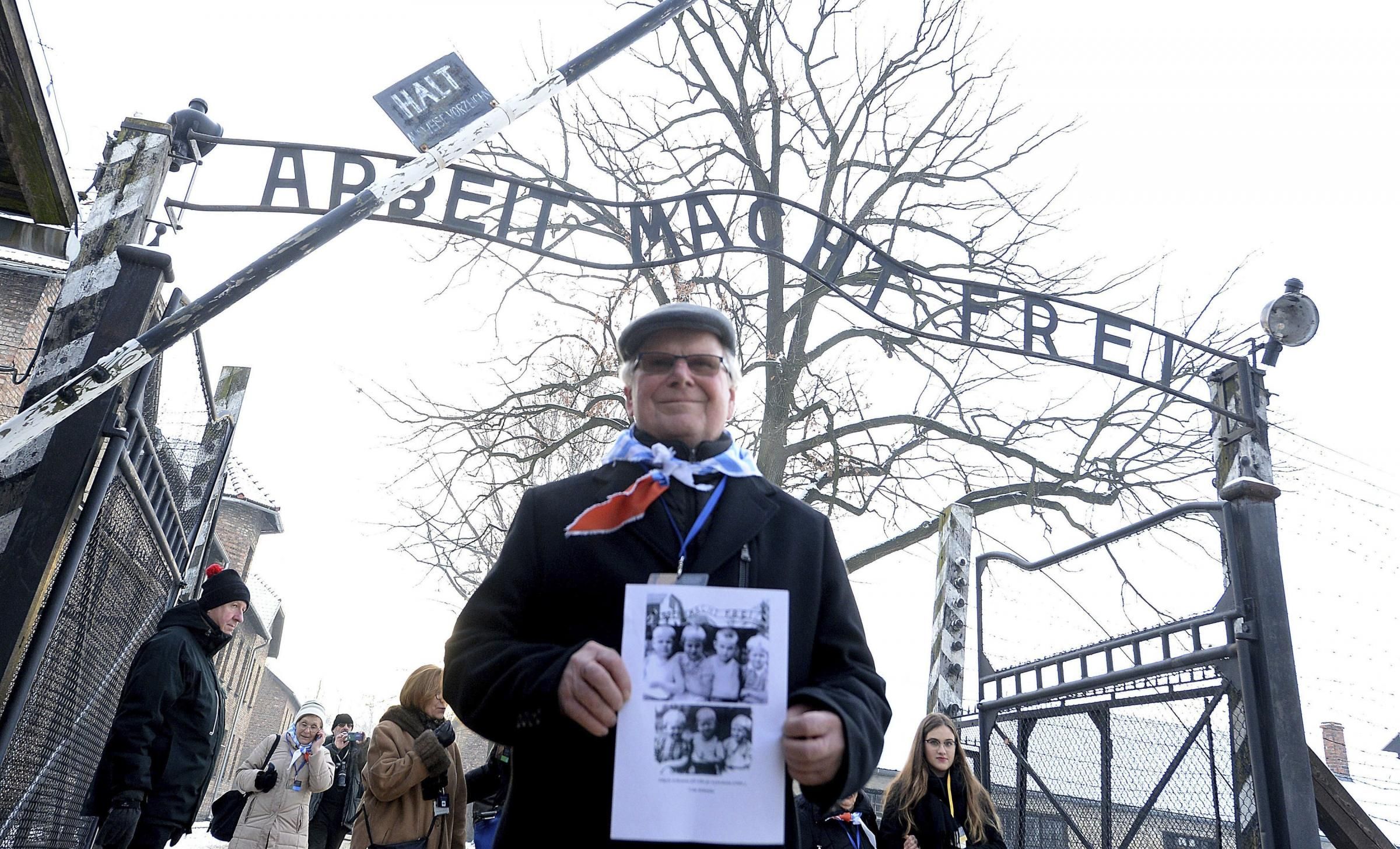 A survivor holds a poster at the former Nazi German concentration and extermination camp Auschwitz, as he attends ceremonies marking the 74th anniversary of the liberation of the camp in Oswiecim, Poland, Sunday, Jan. 27, 2019.(AP/Czarek Sokolowski)