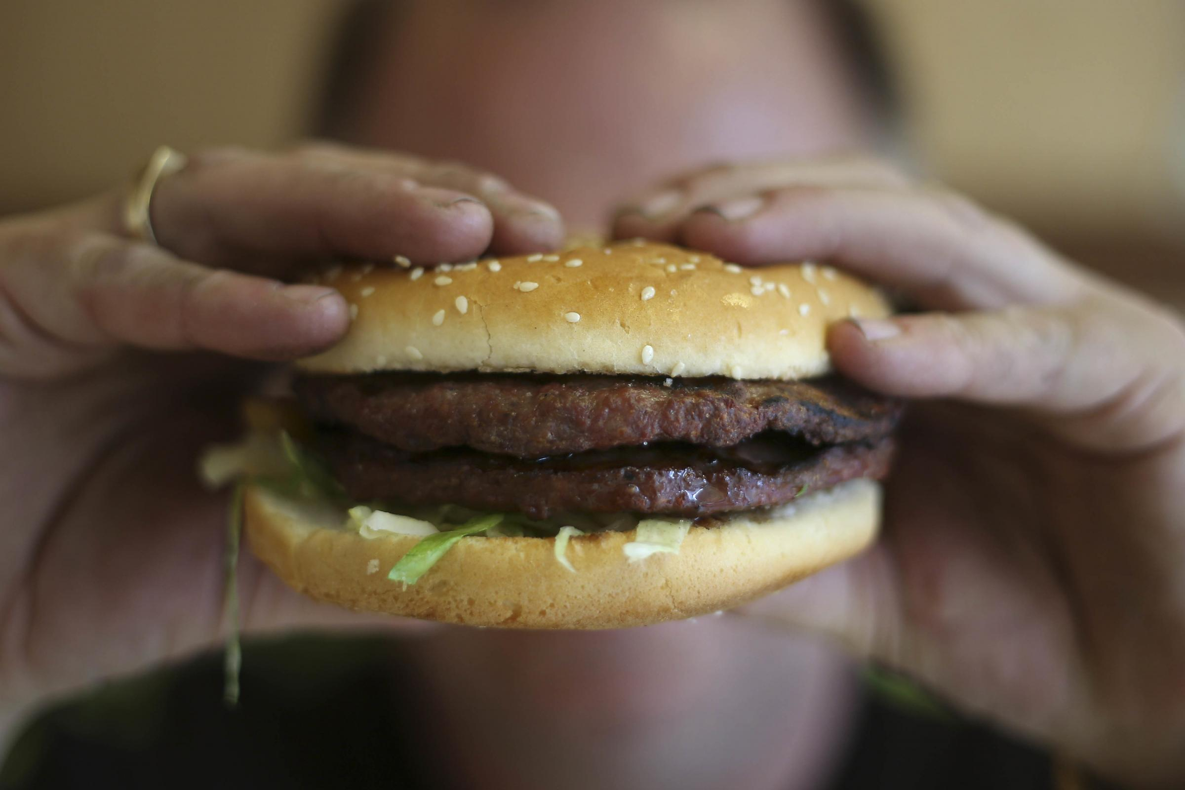 Woman seeks divorce after husband forgot her burger