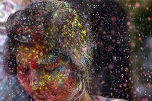 Revelers throw colored powder on a woman during celebrations marking Holi, the Hindu festival of colors, in Mumbai, India. (AP/Rajanish Kakade).