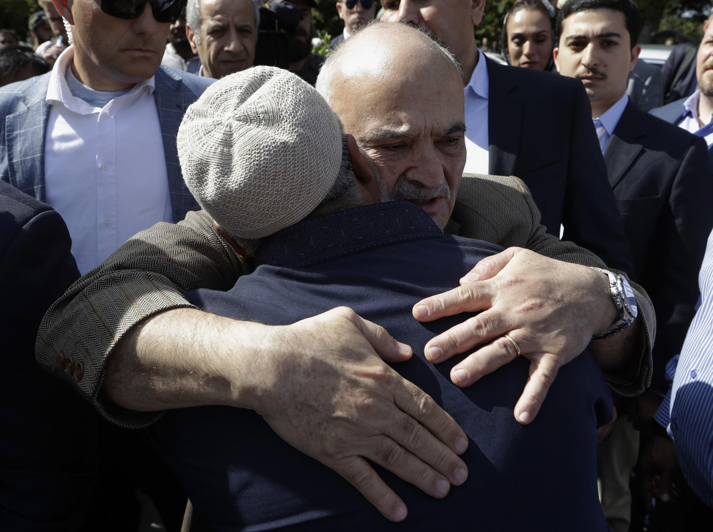 His Royal Highness Prince El Hassan bin Talal Hashemite, of the Kingdom of Jordan, embraces a worshipper outside the Al Noor mosque in Christchurch, New Zealand, Saturday, March 23, 2019 (AP/ Photo)