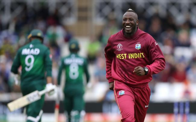 West Indies' Andre Russell celebrates as Pakistan's Imad Wasim walks off after being caught out during the ICC Cricket World Cup group stage match at Trent Bridge. (Tim Goode/PA)
