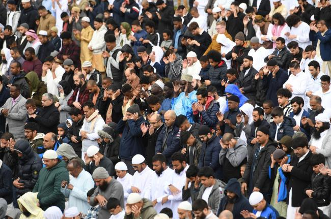 Worshippers attend morning prayer during Eid celebrations in Small Heath Park, Birmingham.. (Joe Giddens/PA)