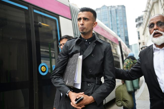 Shakeel Afsar (left) outside the Priory Law Courts in Birmingham during a hearing to reconsider an injunction prohibiting anti-LGBT lessons protesters from being in the immediate surroundings of Anderton Park Primary School.  (King/PA )